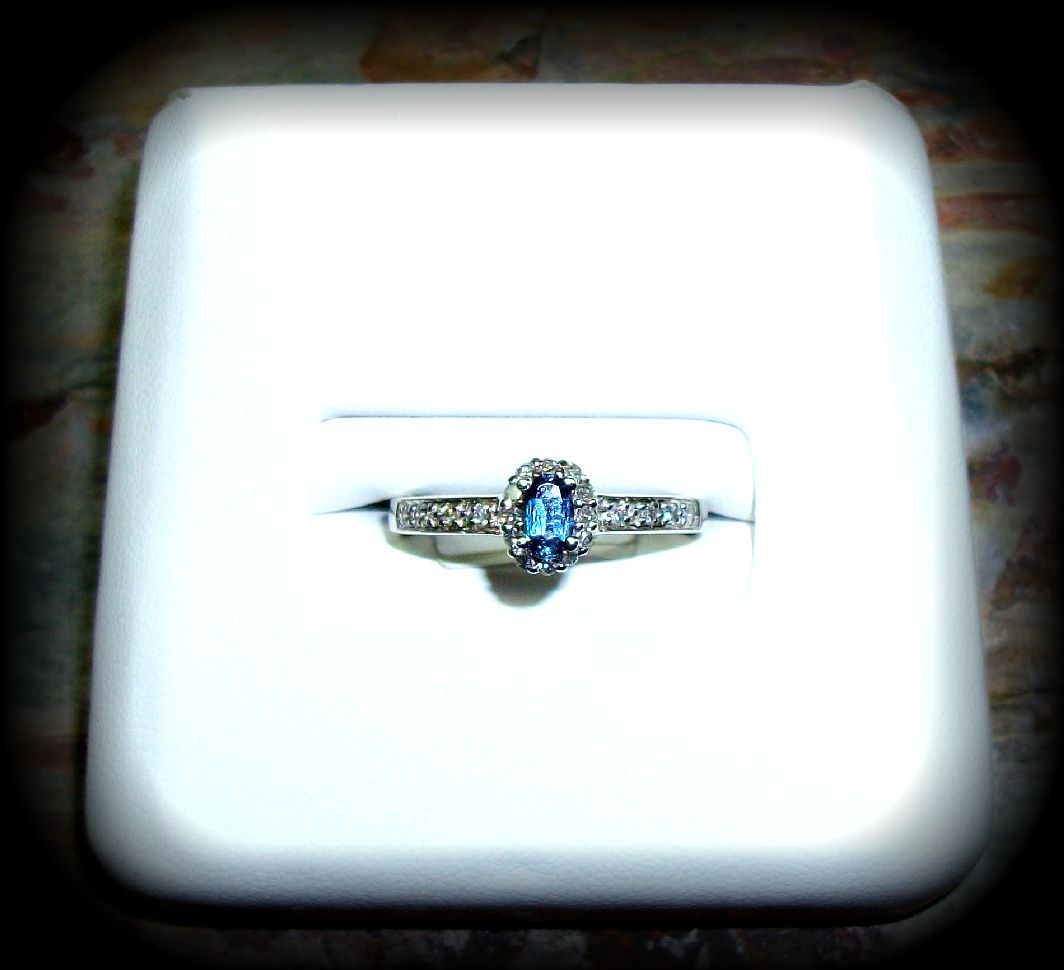 December Blue Topaz Birthstone Ring with Diamonds in White Gold Setting http://www.nationaldiamondcompany.com/#!rings/c22fz