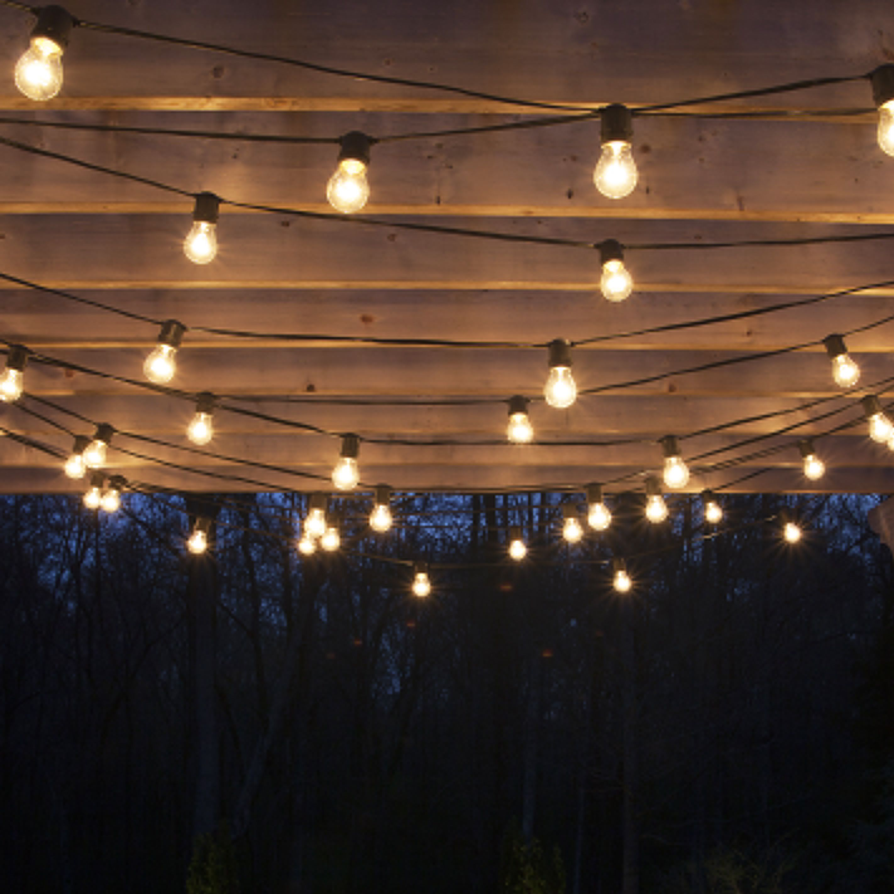 drape patio lights from pergolas - Patio Light Ideas