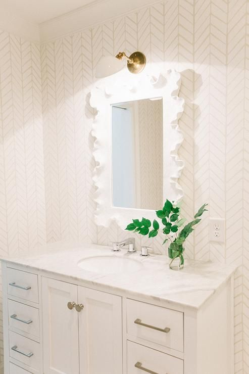 Ballard Designs Wallpaper white bathroom features walls clad in serena & lily feathers