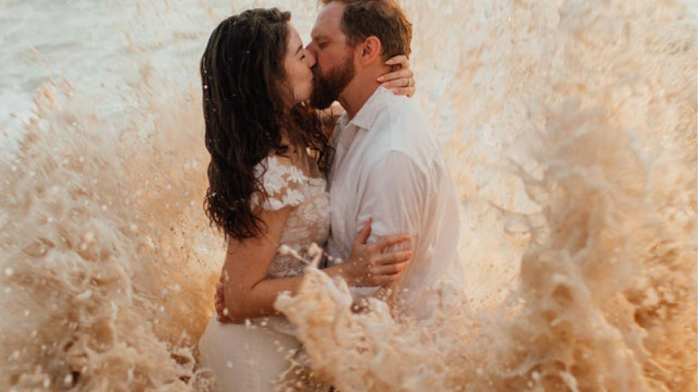Couple's beach wedding photo shoot goes viral after ocean