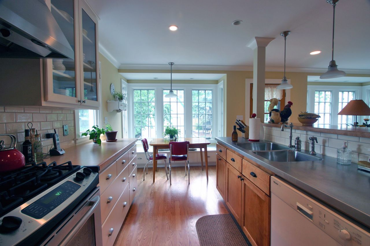 Long Kitchen Layout with Dining Area Facing Windows | Leader ...