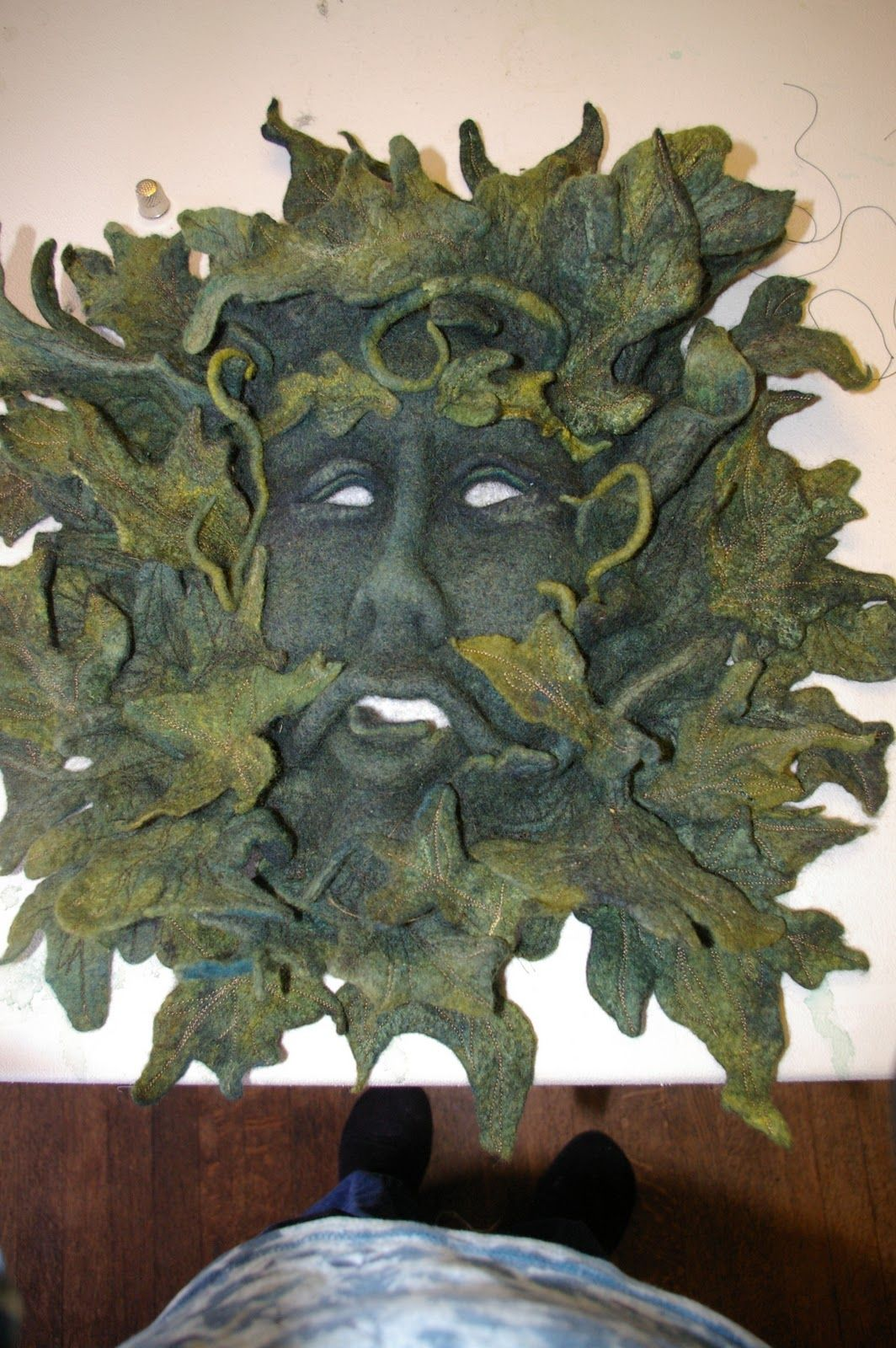 Felted Green Man mask - beautiful.  I had never considered using felt for a mask!