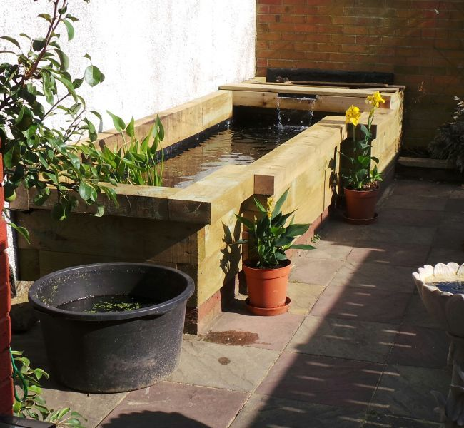 New raised pond made from new pine railway sleepers fish for Garden pond design using sleepers