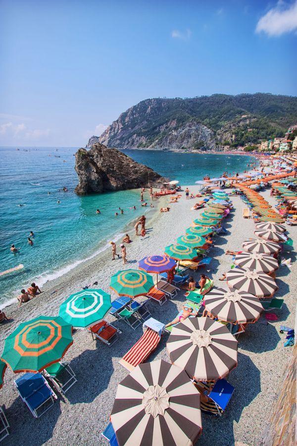 Fun in Sun Italy Cinque Terre Montorosso Beach umbrella swim bath mountain rock water ocean nature travel