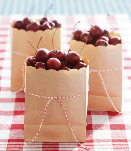 Great idea from Amy Atlas: Transform paper lunch bags into chic little cherry carriers is a pair of scallop-edged scissors — a bit of baker's twine never hurts, too!