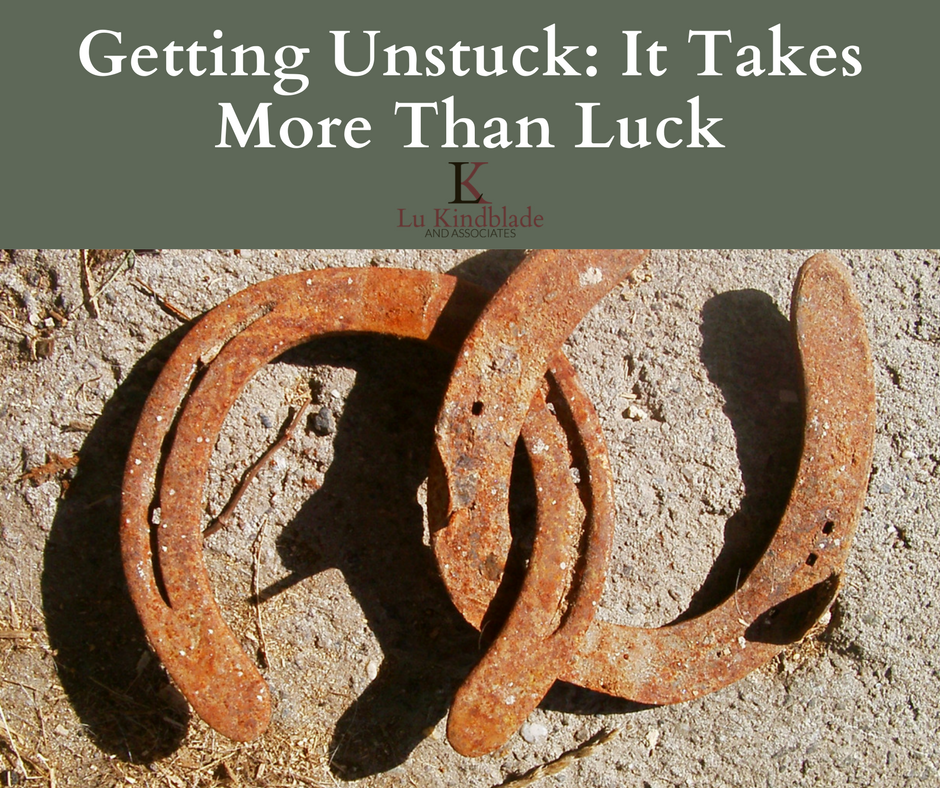 """Do you ever feel """"stuck?"""" Getting unstuck takes more than good luck. It takes goodsolutions. Most of us it seems,especially those of us who WRITE, do get stuck periodically.Usually for me, it happens fortwo basic reasons and I've come up with two solutions: Reason #1. I'm otherwise occupied or over-extended –when I'm busy doing """"real …"""