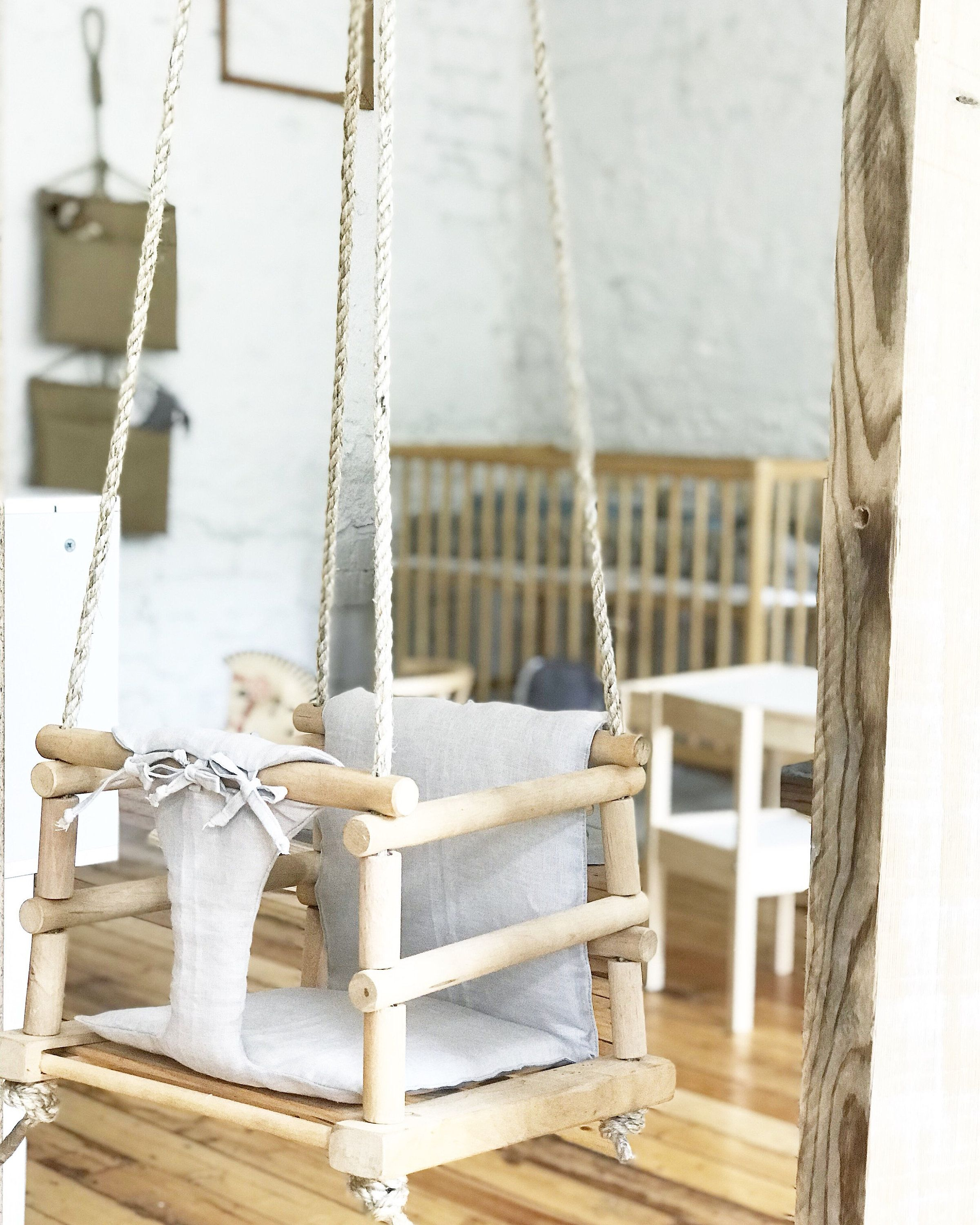 Baby swings wooden with linen padding crib bedding pinterest