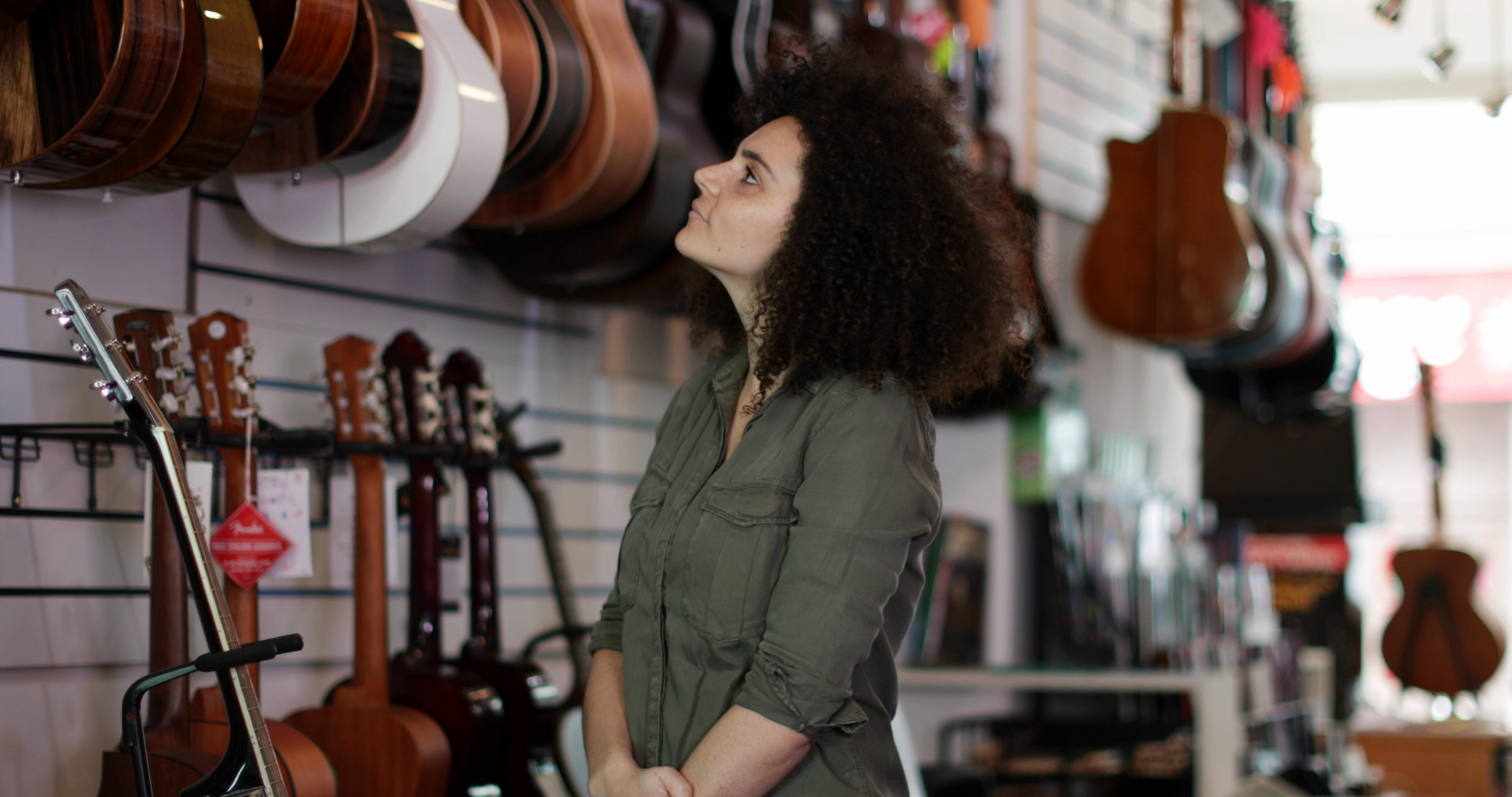Portrait of a small business owner in a guitar store Stock Footage businessownerPortraitsmall