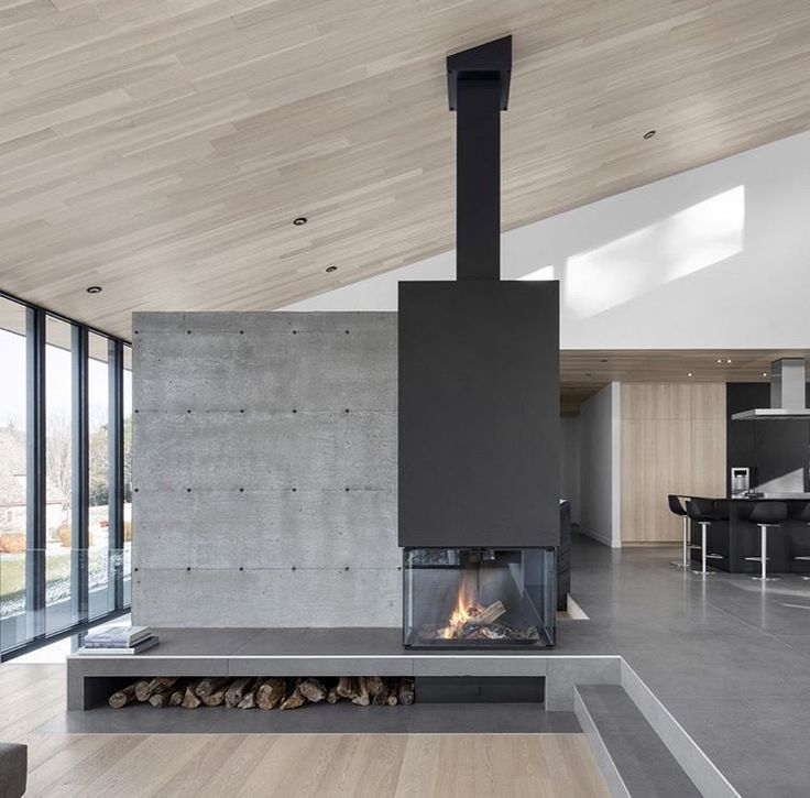 Modern Concrete Fireplace Light Wood Floors And Ceiling