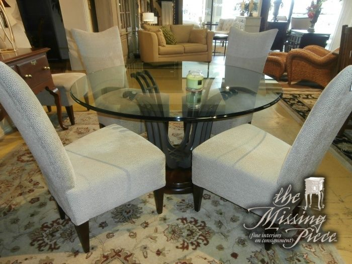 Round Glass Top Dining Table On Wood And Metal Pedestal With Six Curved Parsons Chairs