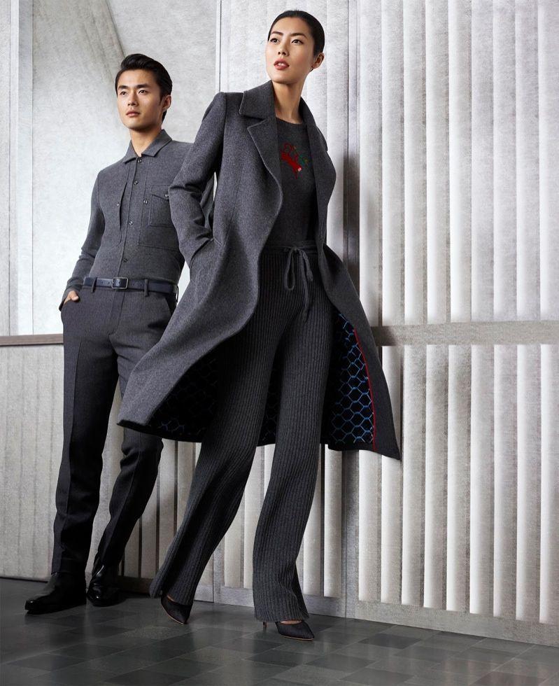 Liu Wen wears a menswear inspired coat and pants look