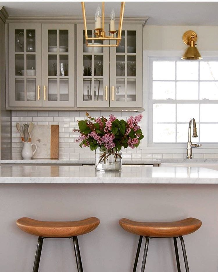 """Krystine Edwards on Instagram: """"What a beautiful and warm kitchen! I love the gray cabinets, the brass and the wooden counter stools. Bravo @lindseyretellehanson"""