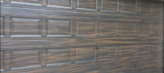 Garage door wood grain painted with our brown wood tones and tiger pattern