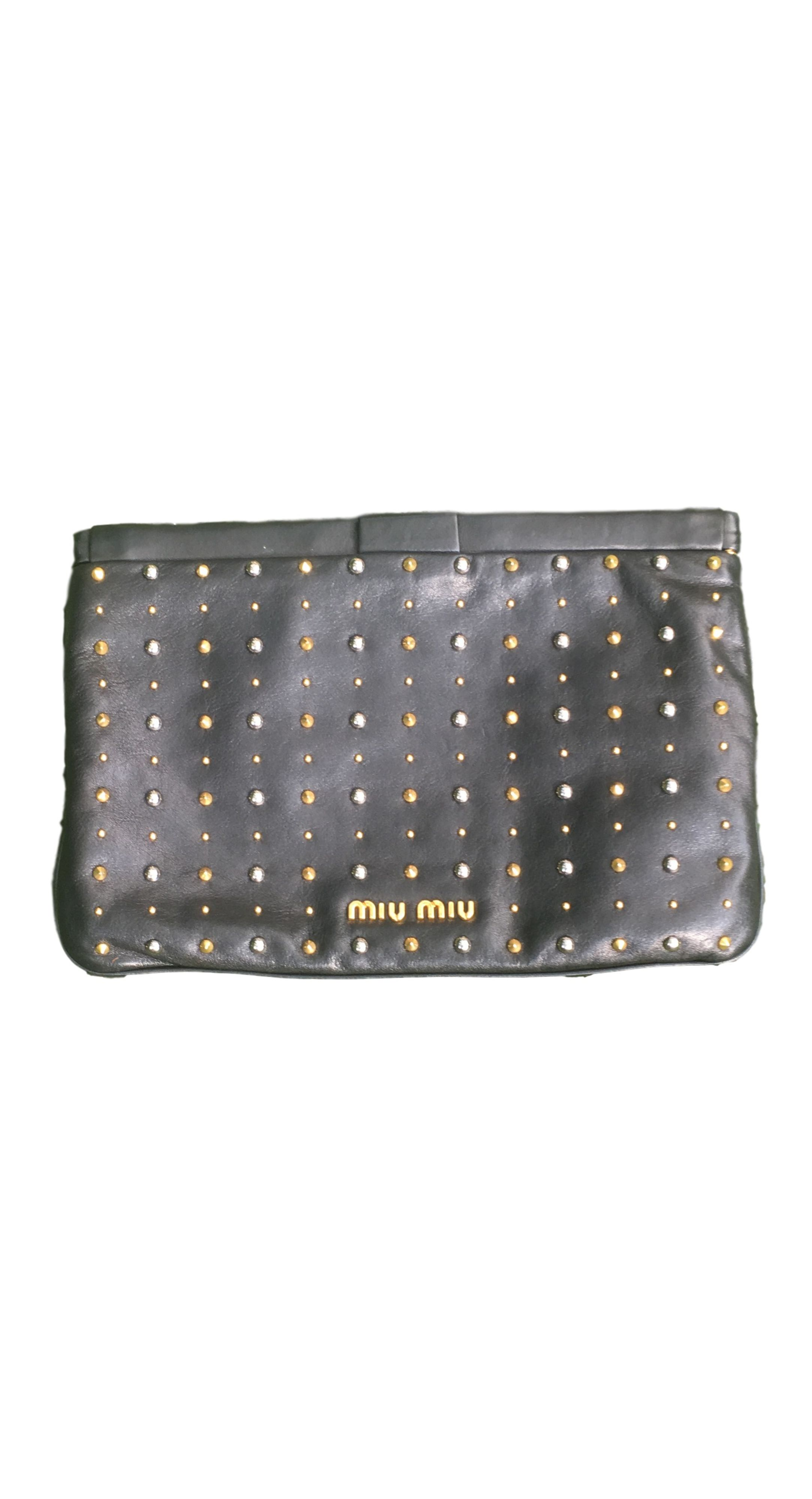 be59d0912548 Our Closet Miu Miu Metallic studded black flat clutch. The perfect little  clutch to add a modern touch to LBD.