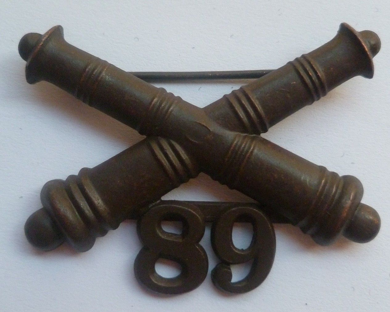 Post WW1 United States 75th Artillery Garrison Hat Badge