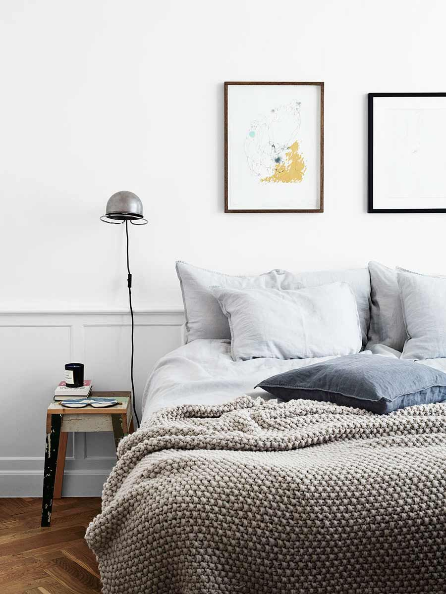 Simple linen bedspread in Scandinavian bedroom style