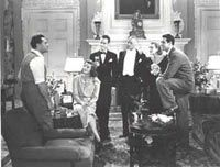 George Cukor (left) directs Katharine Hepburn, Lew Ayres, Henry Kolker, Doris Nolan and Cary Grant in a scene from «Holiday» (1938)