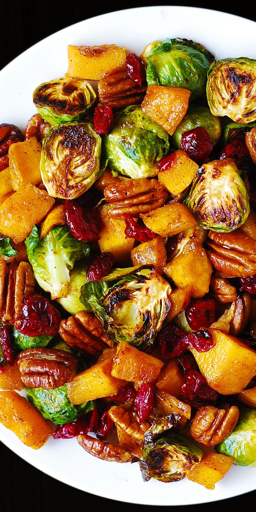 Thanksgiving Side Dish: Roasted Butternut Squash and Brussels sprouts with Pecans and Cranberries #dinnersidedishes