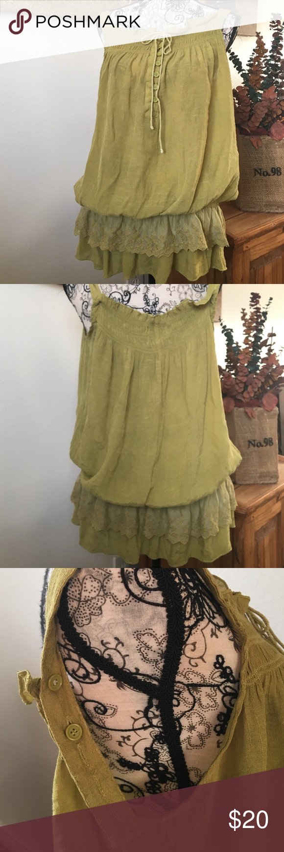 CAREN SPORT TOP Olive green top. Elastic waist garnished with ruffles and lace, ties in front and adjustable straps. This top is gorgeous!!  Tag was removed but I would say xxl Caren sport Tops Blouses