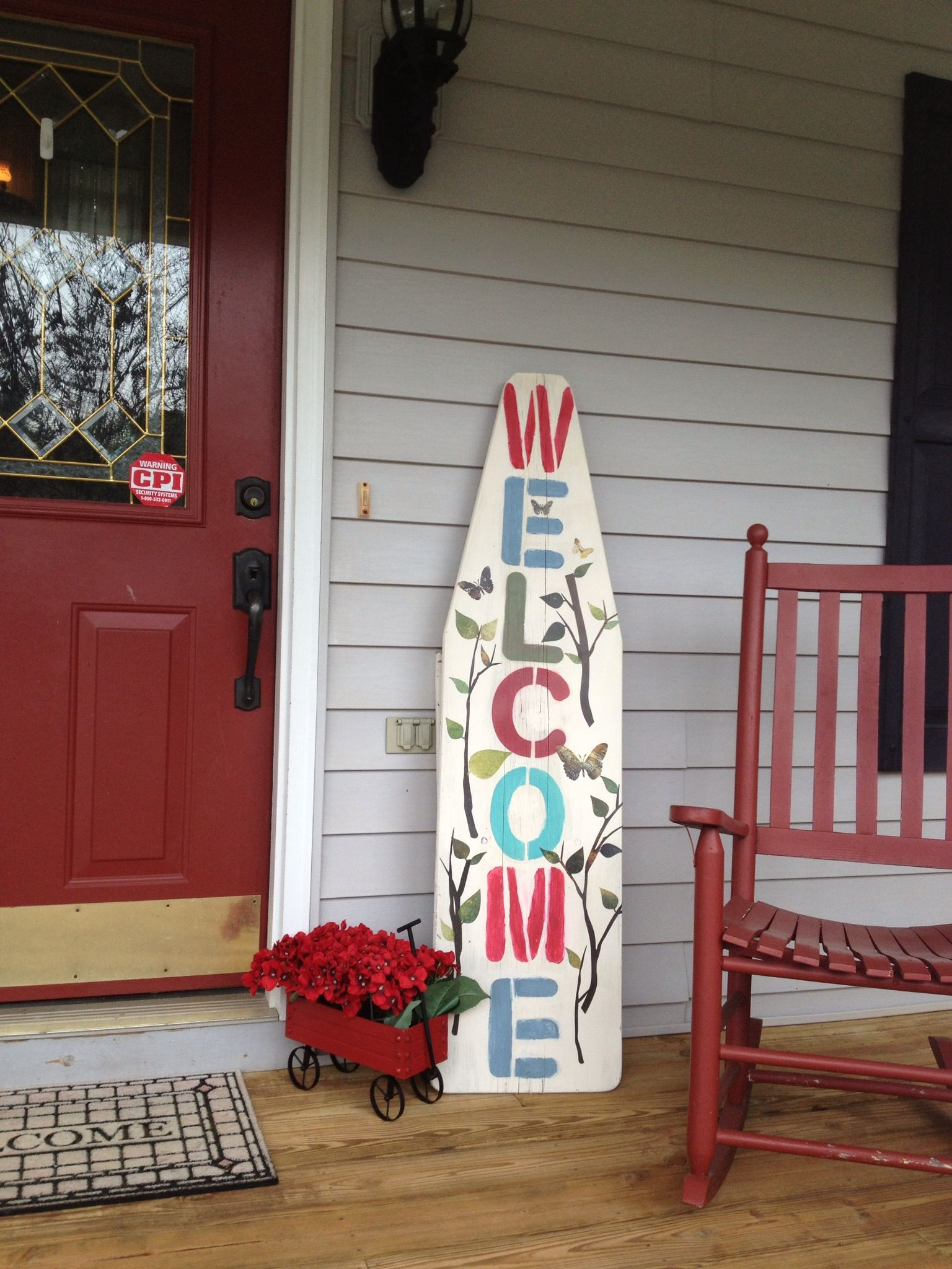 Painted WEL E sign for cottage front porch stenciled on vintage