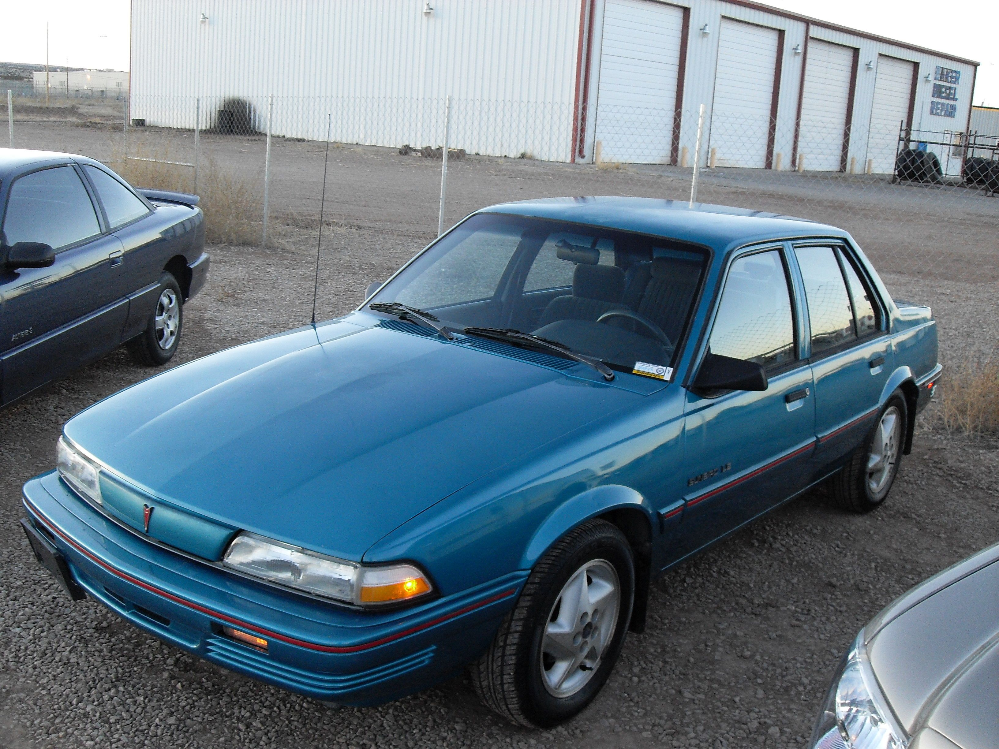 1992 pontiac sunbird 4 door the wife s aqua blurr
