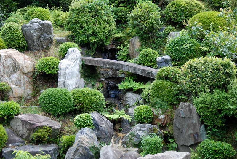 a stone bridge halfway up the miniature mountain chishaku in kyoto japan - Japanese Garden Stone Bridge