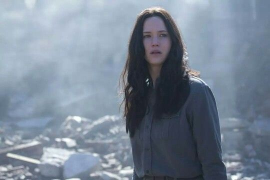 Katniss visits back to district 12 well at least the ruins of what used to be district 12 she becomes furious and sings the hanging tree