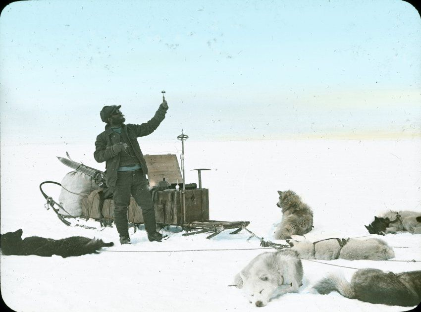 The Swiss Greenland Expedition 1912 - The expedition leader at work with an anemometer: The Swiss geophysicist Alfred de Quervain.