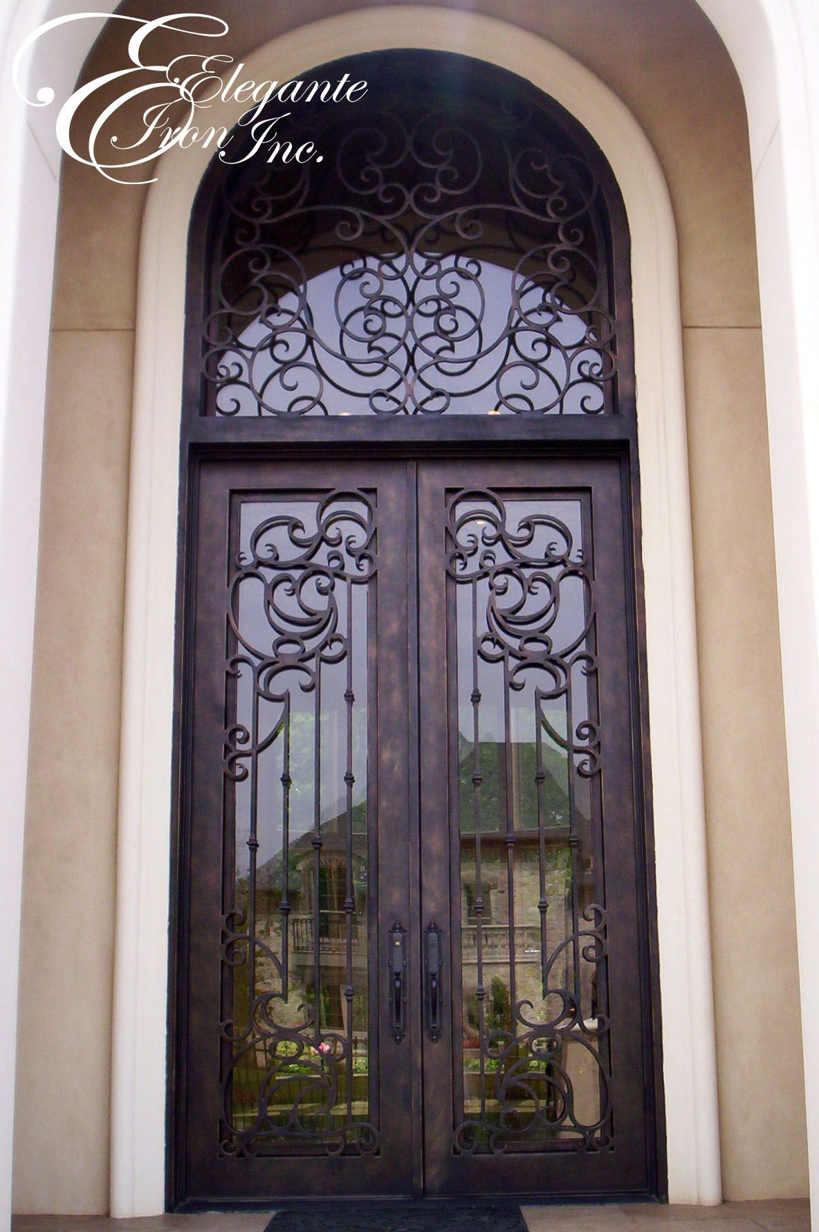 Custom wrought iron door with transom double doors for Wrought iron entry doors