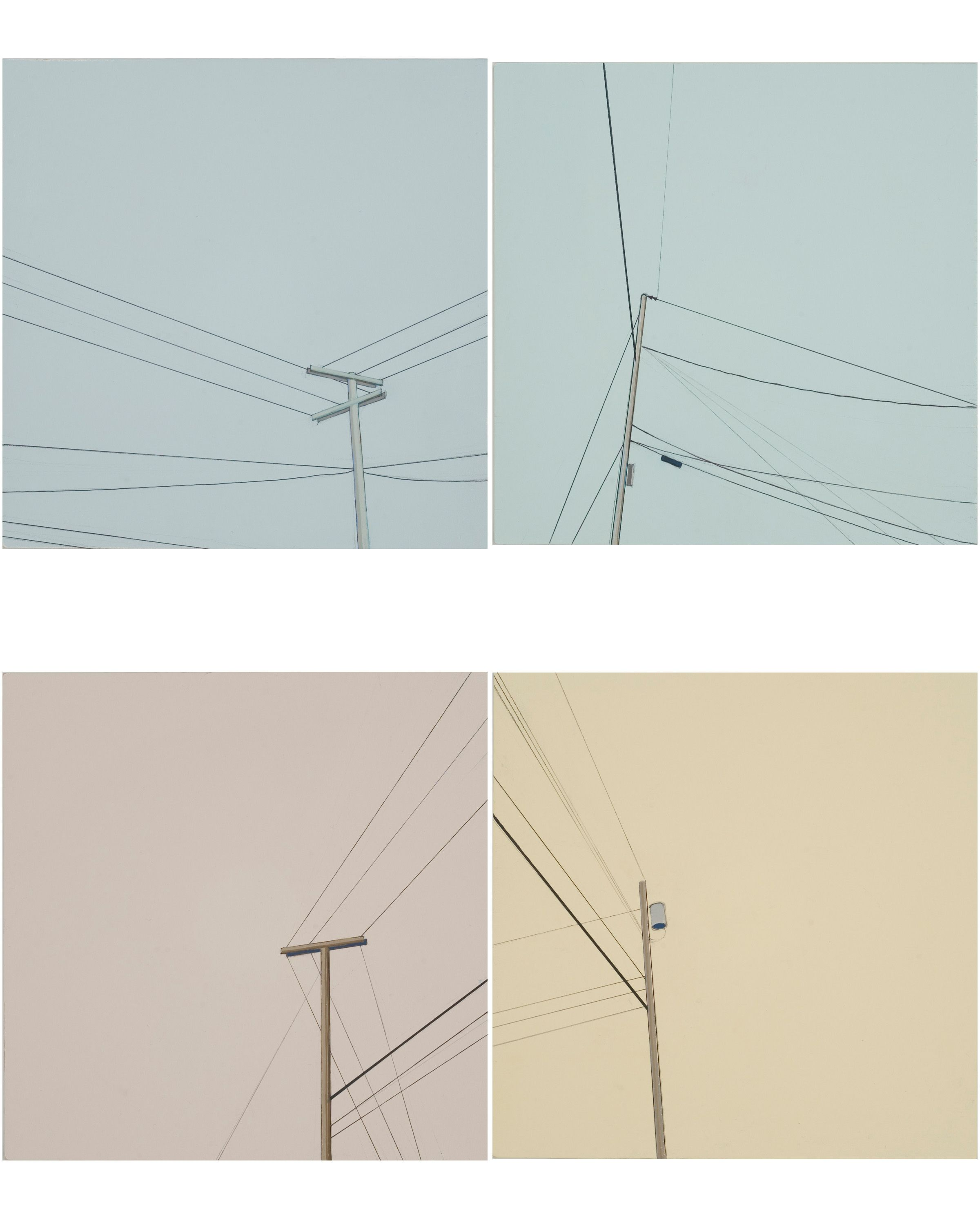 A series of four utility poles