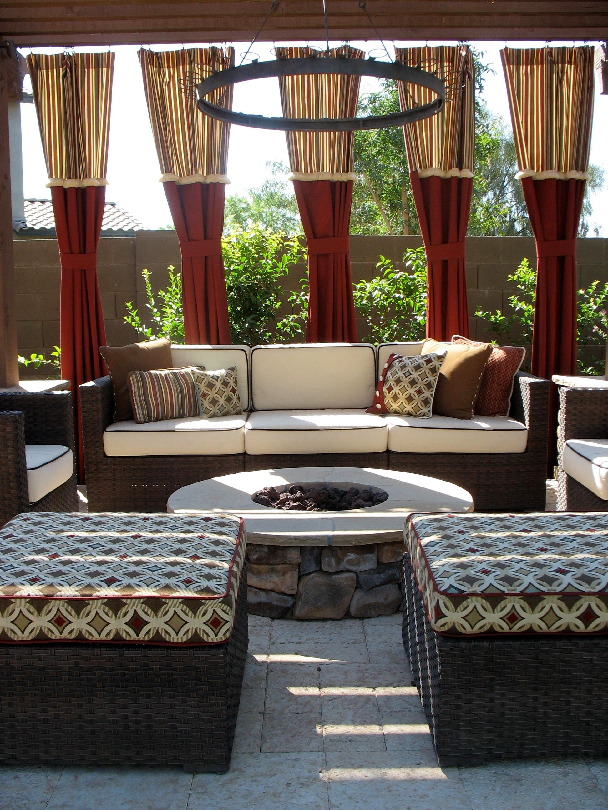 Backyard pergola with firepit. Drapes, cushions, and pillows done in Sunbrella fabrics. Furniture purchased on Overstock.com.
