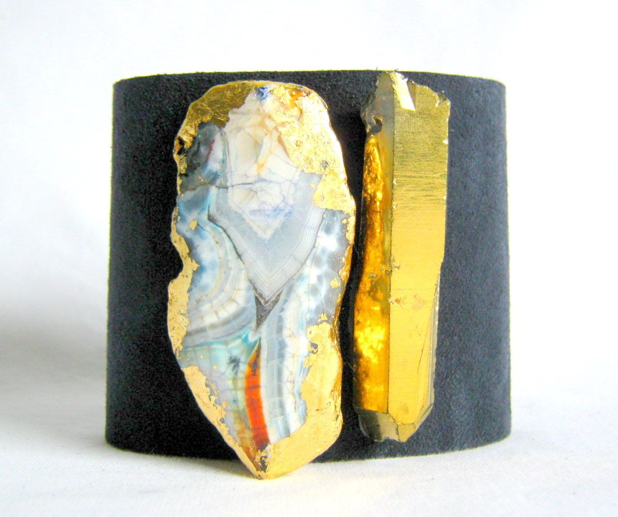 women's suede cuff bracelet in monaco blue with gilded agate and gold crystal quartz point- size 1. $50.00, via Etsy.