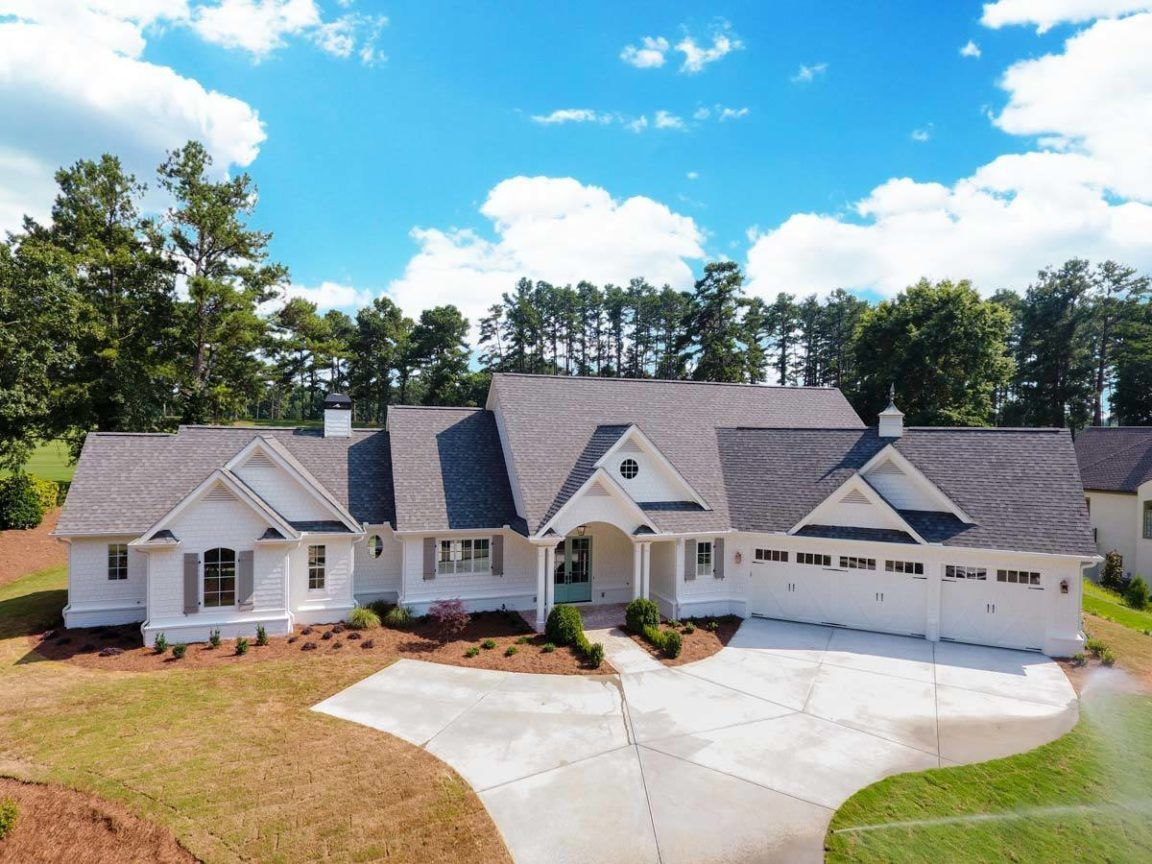 Two Story 4 Bedroom Country Craftsman for a Wide Lot with Angled and Golf Cart Garages Floor Plan