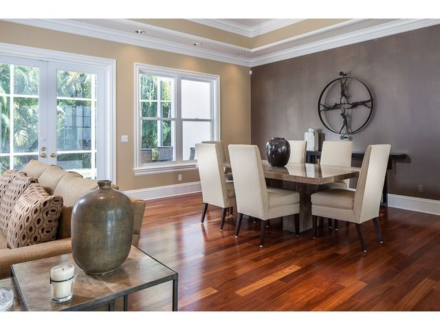 Neutral Dining Room White Chairs Dark Accent Wall