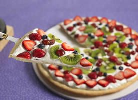 Sweet pizza with sugar-cooke crust, frosting, whipped cream and fresh fruit