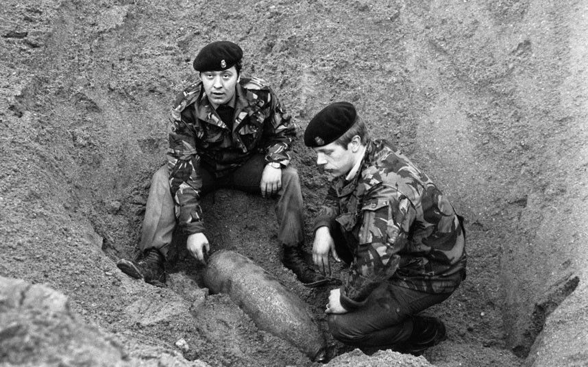 Bomb disposal squad defusing live bomb from WWII