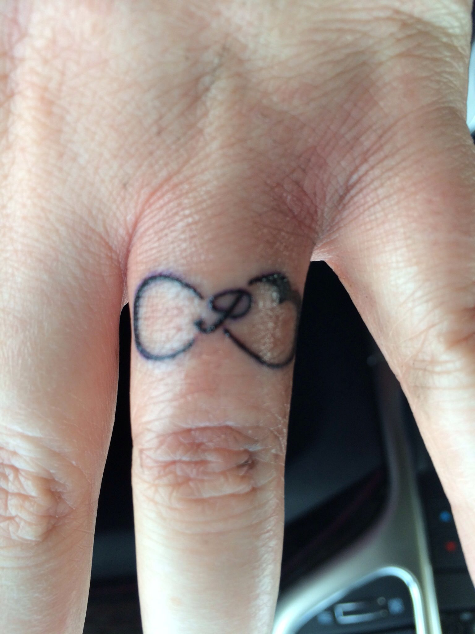 Infinity heart and last name initial ring tattoo I LOVE IT