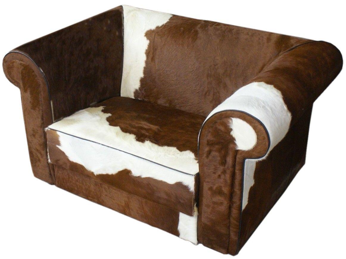 Bertha loveseat in bruin met wit koeienhuid fauteuils met