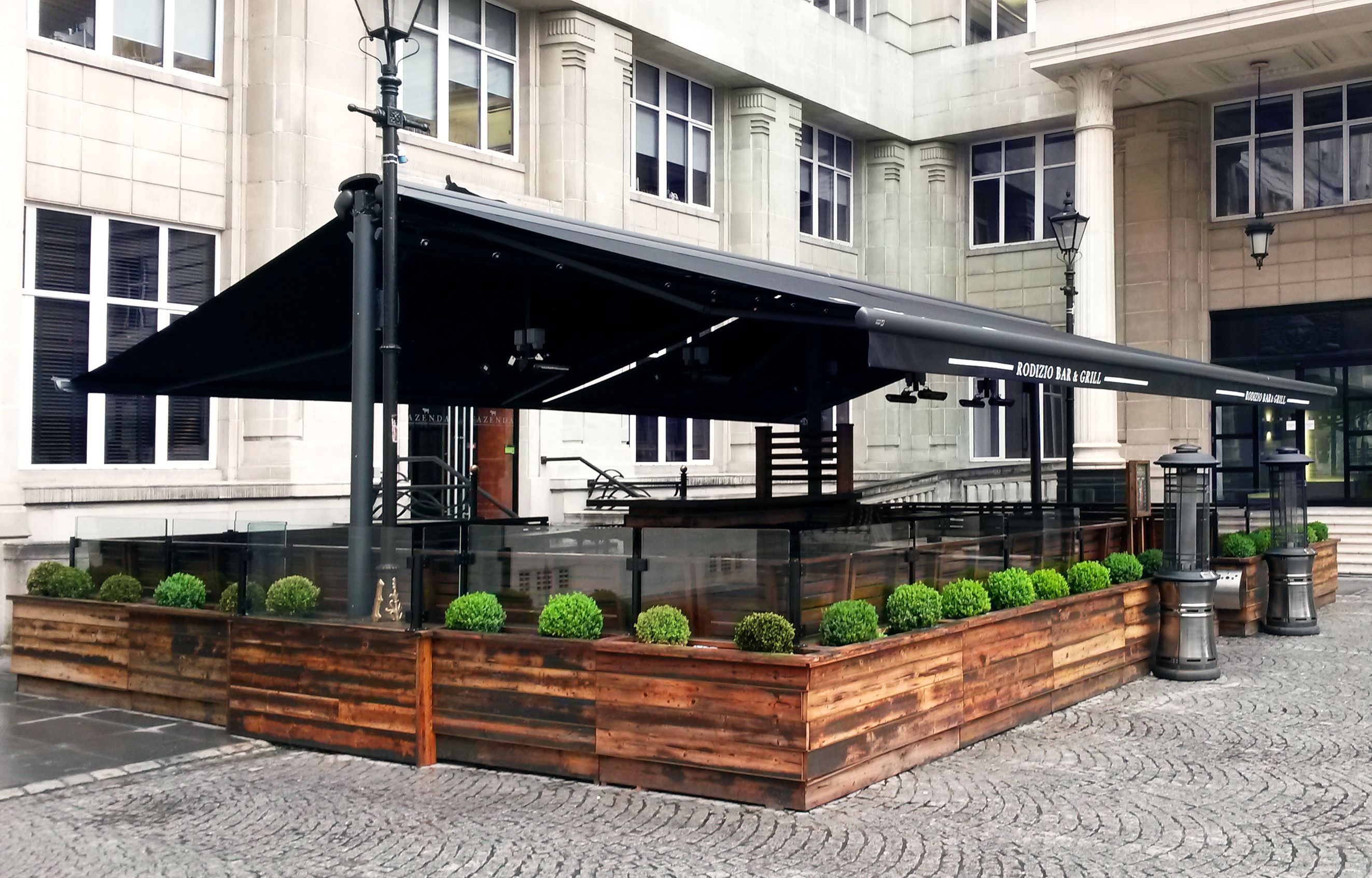 Butterfly Awning With Branded Valances Heaters And Planters See