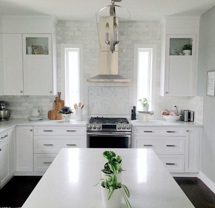 Best Classic White Kitchen With Marble Subway Tile Backsplash 400 x 300