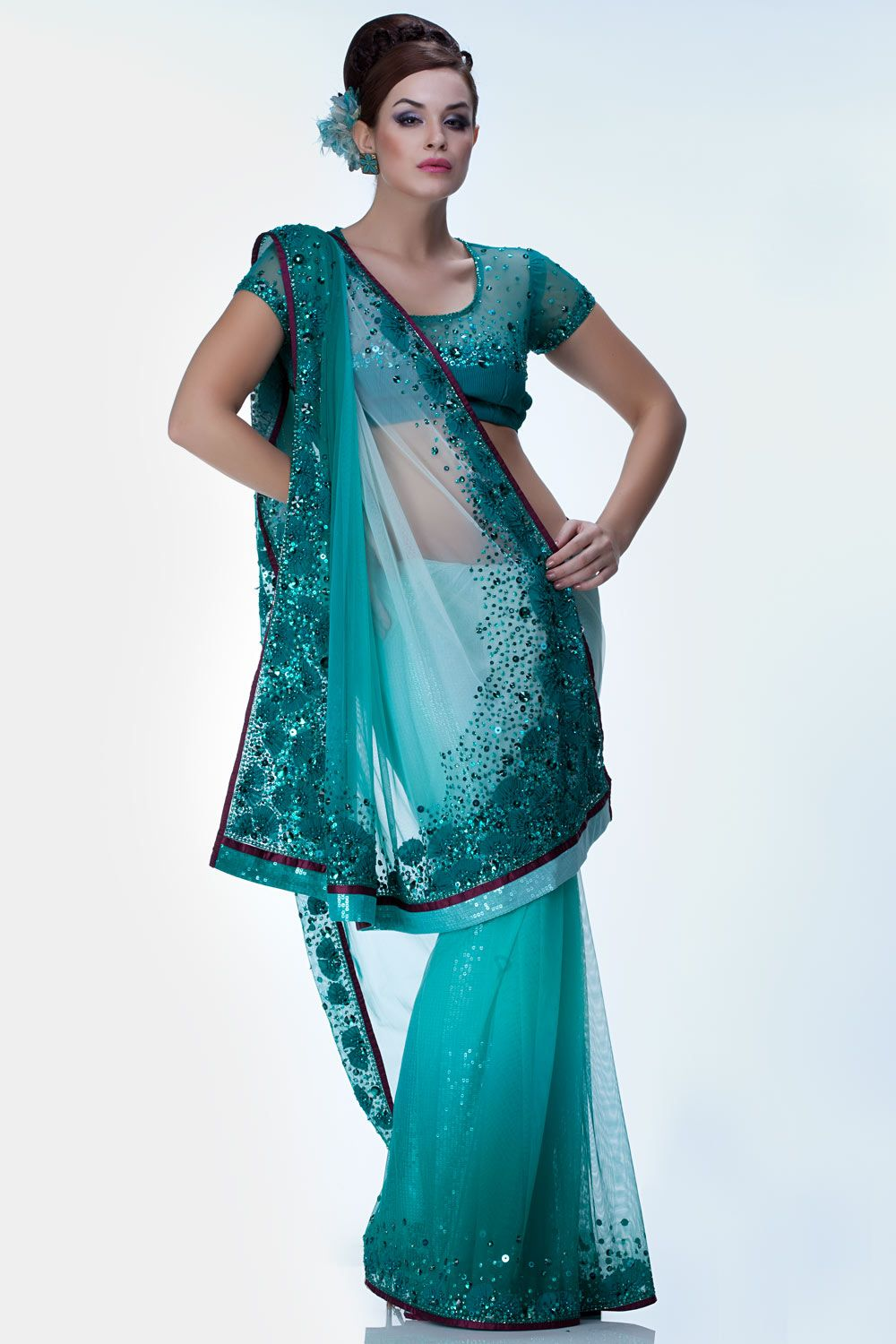 Designed by Satya Paul. This saree is a conceptual design product that shows embroidery inspired by elements of the sea. The pleats signify the texture on shells as they are embedded to the border.