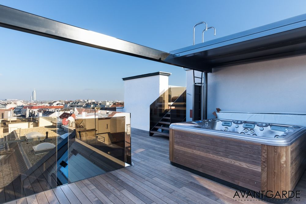 Modern penthouse terrace with jacuzzi and teak floor luxury real