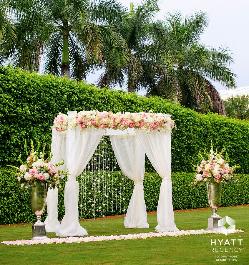 Gorgeous Pink And Champagne Flowers Adorn This Formal Outdoor