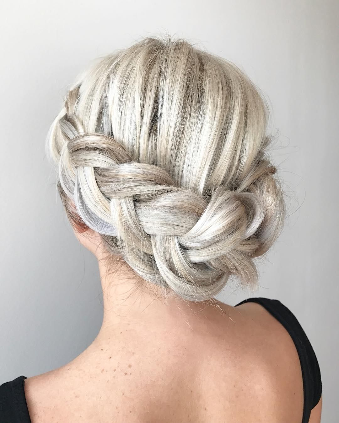Braid Hairstyles For Wedding Party: Thick Textured Platinum Blonde Dutch Braids From Aveda