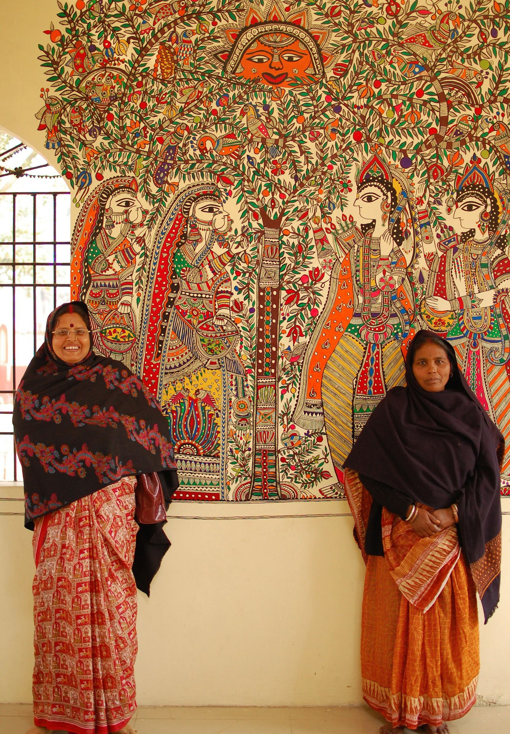 Artists in front of their mural in Madhubani Street Art