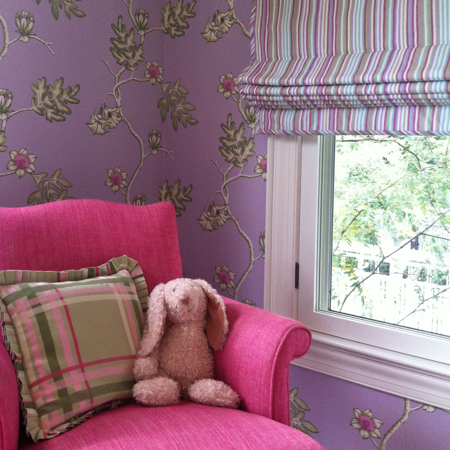 An SBS designed nursery in DC. Featuring #manuelcanovas wallpaper, roman shade fabric by Zoffany, and chair and pillow fabric by Osborne & Little.  www.solisbetancourt.com