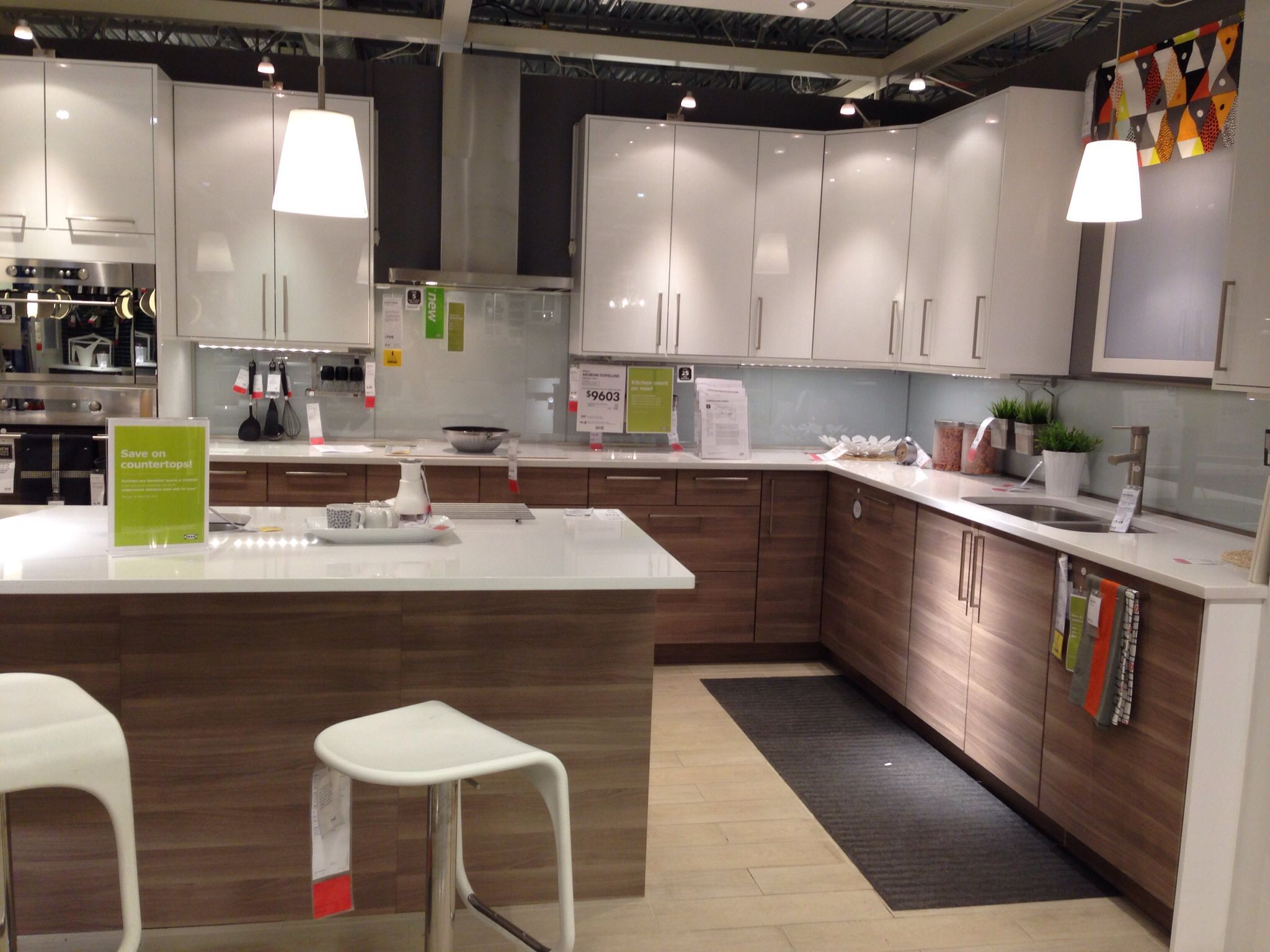 Walnut lower cabinets with white uppers, accent colour backsplash ...