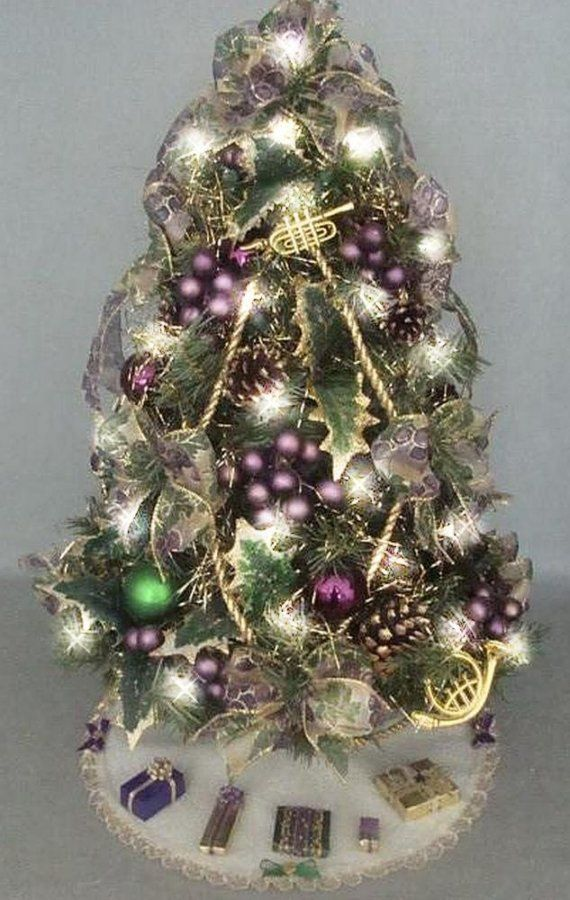 this listing is for a gorgeous one of a kind fully decorated and lit artificial mini tabletop christmas tree tree skirt and matching