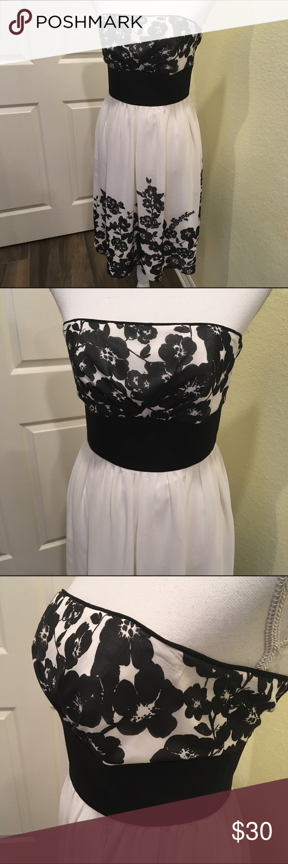 White House black market dress size 4 Beautiful dress great for any occasion. Is polyester so fairly wrinkle resist. Measures 15.5 across at bust and 15 across at waist and about 35 inches long that's from arm pit to hem line. It is strapless. White House Black Market Dresses Midi