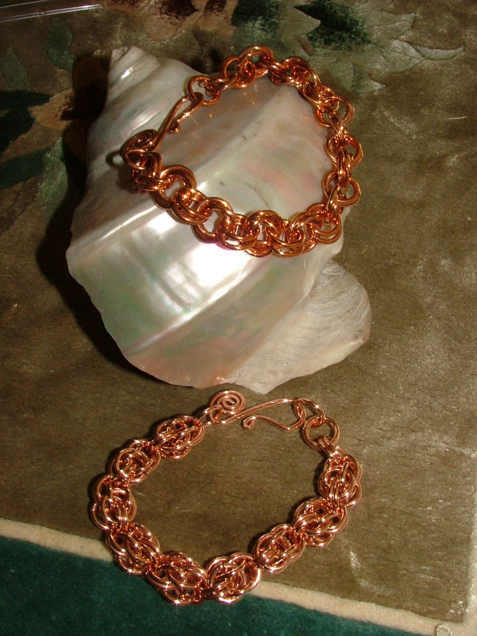 Copper chain maille bracelets.